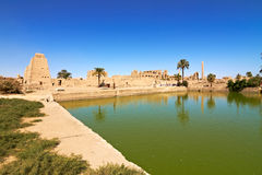 Sacred lake in Temple of Karnak, Egypt. The lake served for ritual purposes and for the purification of the priests Stock Photography