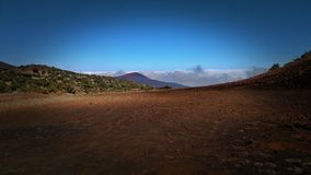 Sacred Mauna Kea Volcano. A view from the summit of Mauna Kea, a sacred volcano/sea mountain/creator and site to this planet. Keep her safe and untouched by mans Royalty Free Stock Photography