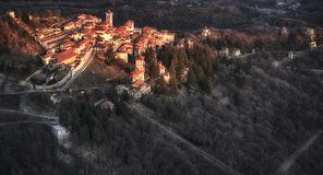 Sacred Mount of Varese at the sunset. Warm sunny light on the ancient village of Sacred Mount of Varese in a winter afternoon Stock Images