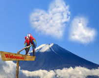 The sacred mountain of Fuji in the background of blue sky Royalty Free Stock Image