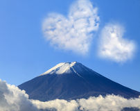 The sacred mountain of Fuji in the background of blue sky Stock Photo