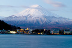 Sacred mountain of Fuji on  top covered with snow in Japan. Royalty Free Stock Images