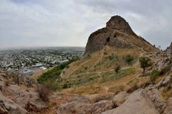 Sacred muslim mountain Suleiman-Too in Osh,Kirgyzstan,Fergana valley. Its five peaks and slopes contain numerous ancient places of worship and caves with stock images