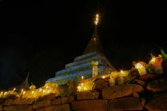 Sacred pagoda flanking with ritual candles,incense,lotus Stock Image
