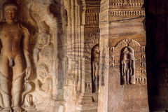 Sacred place of Jainism, reliefs of meditating men inside the 7th century cave temple, in town Badami, India Stock Images