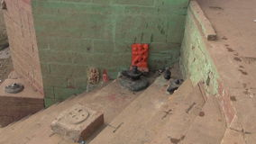 Sacred place with lingam and gods near Ganges river, Varanasi stock video