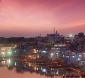 Sacred Puskhar lake (Sagar) and ghats of  town Pushkar in twilig Stock Photos