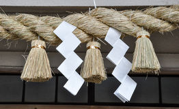 Sacred rice straw rope in Shinto shrine. And temple Royalty Free Stock Photography