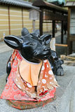 Sacred statue of black marble cow outside Kadai-ji Temple in Kyo. Soft forcus of sacred statue of black marble cow outside Kadai-ji Temple in Kyoto, Japan. It' Royalty Free Stock Image