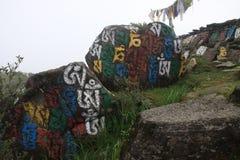 Sacred stones in Himalaya. Stones with Sanskrit letters nearby Old monastery in West Bengal during Sandakphu trek stock image