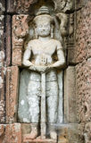 Sacred Sword Statue, Angkor, Cambodia. Ancient Khmer sculpture of a Dvarapala deity holding a sword and guarding Preah Khan Temple, Angkor, Siem Reap, Cambodia Stock Photos
