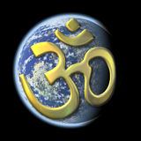 Sacred syllable Aum on Earth. An image of a the earth with the golden sacred syllable Aum Royalty Free Stock Images