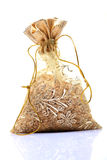 Sacred wheat seeds. In pouch isolated on white background Royalty Free Stock Photography