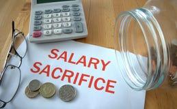 Sacrifício do salário Foto de Stock