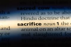 Sacrifice. Word in a dictionary.  concept royalty free stock image