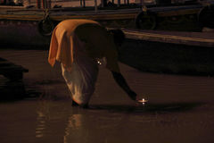 Sacrifice to the Ganges river at night Stock Photos