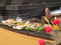Sacrifices and incense in a Buddhist temple. Sacrifice oblation, traditional offerings for Gods in Buddhist temple, Bali. Sacrifice, oblation , belief Royalty Free Stock Photography