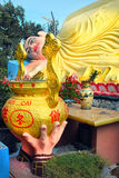 A sacrificial bowl in front of the Reclining Buddha Royalty Free Stock Photos