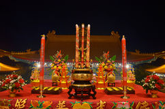 Sacrificial offering or oblation with joss stick and candle pray for God Stock Photography