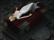 Sacrificial virgin on altar from overhead. Overhead view of blonde virgin in diaphanous white gown lying drugged on stone altar Royalty Free Stock Photography