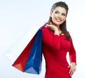 Sacs à provisions de prise de femme sur le fond blanc Images stock