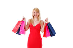 Sacs à provisions de sourire de fixation de femme images stock
