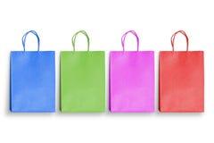 Sacs colorés d'isolement pour l'achat Photographie stock libre de droits