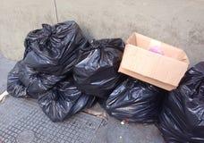 Sacs d'ordures noirs Photos stock