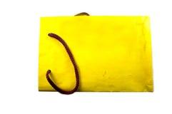 Sacs de boutique de Yelow sur le blanc Photographie stock libre de droits