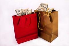 Sacs de cadeau avec des dollars Images stock