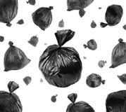 Sacs de déchets noirs sur le blanc photographie stock