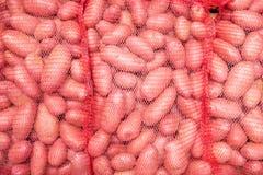 Sacs de fond de pommes de terre Photographie stock