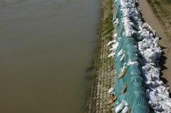 Sacs de sable contre des inondations Photographie stock libre de droits