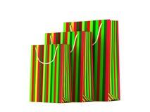 Sacs en papier colorés de Noël d'isolement sur le fond blanc Image libre de droits