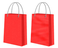 Sacs en papier rouges d'achats de papier d'emballage Photo libre de droits