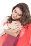 Sacs à provisions de transport de jeune fille Photographie stock libre de droits