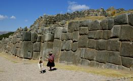 Sacsayhuaman, lama, native woman Royalty Free Stock Images
