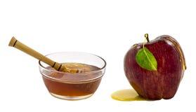 Sacuda con la miel y la manzana aisladas en blanco Imagen de archivo libre de regalías