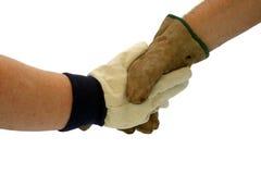 Sacudida con guantes de la mano Fotografía de archivo libre de regalías