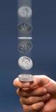 Sacudida de la moneda. Fotografía de archivo libre de regalías