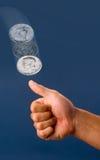 Sacudida de la moneda. Foto de archivo libre de regalías
