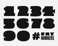 Sadło liczby ustawiać w czarnym kształcie Fotografia Royalty Free