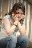 Sad. Teen girl depressed sitting on steps Royalty Free Stock Photos