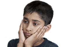 Sad. An handsome Indian kid looking very sad Royalty Free Stock Photo
