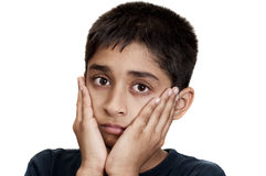 Sad. An handsome Indian kid looking very sad Royalty Free Stock Image