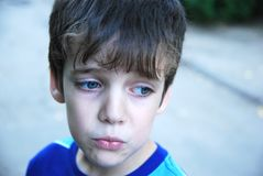 Sad 7 years old boy portrait. Stock Images