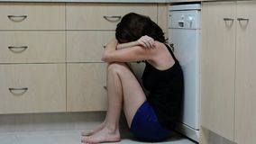 Sad abused woman. Crying in kitchen stock video footage