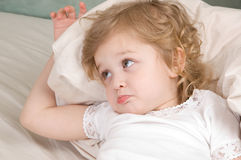 Sad adorable little girl. In the bed closeup Royalty Free Stock Images