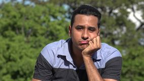 Sad Adult Hispanic Man. A handsome adult hispanic man stock footage