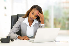 Sad african american businesswoman. Sitting in modern office Stock Photo